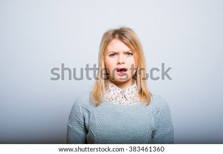 beautiful girl angry at you, isolated on a gray background