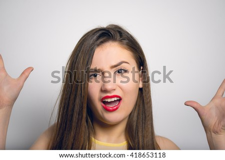 beautiful girl angry shouts, in a yellow dress, closeup isolated on white background - stock photo