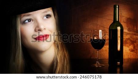 Beautiful girl as good red dark tart wine. - stock photo