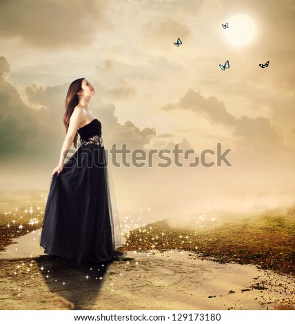 Beautiful girl at a brook under the moon light (with butterflies) - stock photo