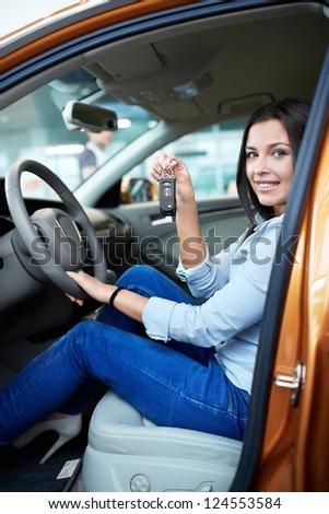 Beautiful girl behind the wheel - stock photo