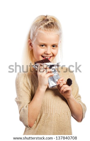 Beautiful girl biting chocolate. Isolated on white background. - stock photo