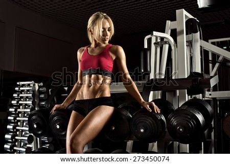 beautiful girl bodybuilder,  execute exercise with  weight - stock photo