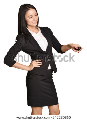 Beautiful girl broker holding sale auto key. white background - stock photo