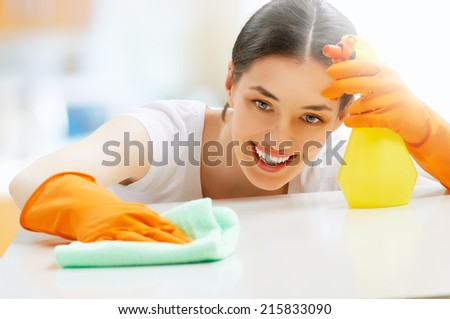 beautiful girl cleans the surface - stock photo