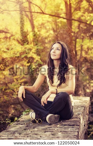 Beautiful girl contemplate in nature - stock photo
