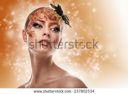 Beautiful Girl. Creative Fashion Makeup. Fantasy background. - stock photo