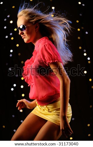 Beautiful girl dancing - stock photo