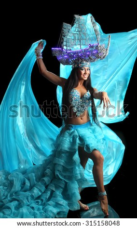 beautiful girl dancing in blue hat. active dancer in a lush, gorgeous dance costumes. dance movements, artistic emotions - stock photo