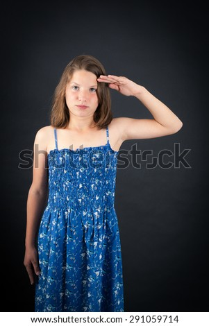 Beautiful girl doing different expressions in different sets of clothes: at attention - stock photo