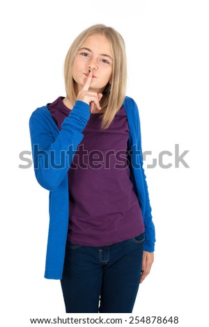Beautiful girl doing different expressions in different sets of clothes: be quiet - stock photo