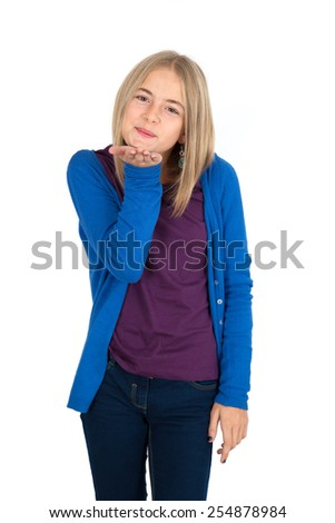 Beautiful girl doing different expressions in different sets of clothes: kiss - stock photo