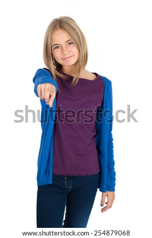 Beautiful girl doing different expressions in different sets of clothes: pointing - stock photo
