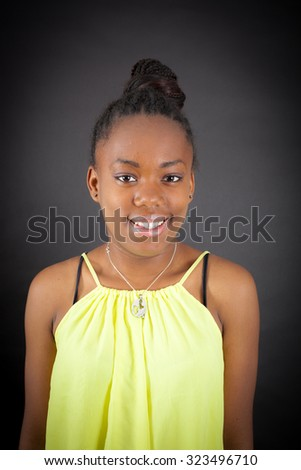 Beautiful girl doing different expressions in different sets of clothes: smile - stock photo