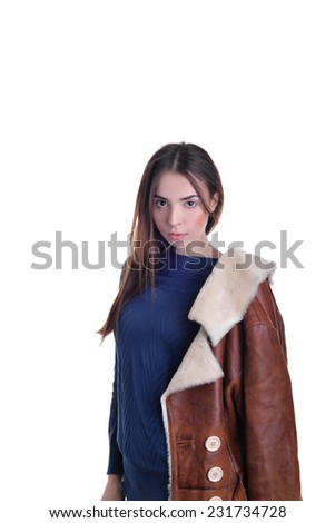 beautiful girl dressed in fur leather jacket on isolated background - stock photo