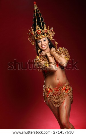 beautiful girl dressed like a Thai dancer. dance moves. beautiful colorful costumes, vivid emotions - stock photo