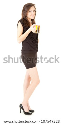 beautiful girl drinking beer from the mug, full length, white background - stock photo