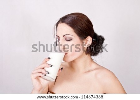 Beautiful girl drinking milk - stock photo