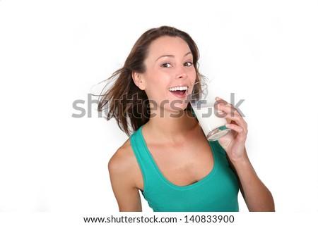 Beautiful girl drinking milk from glass - stock photo