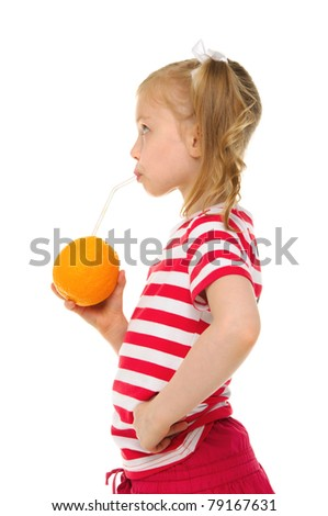 Beautiful girl drinking orange juice through straw isolated on white