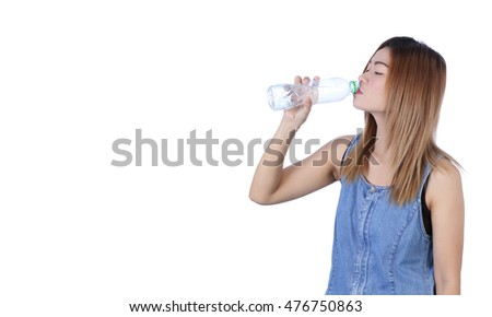 Beautiful girl drinking water from blue bottle. isolated on white , Asian girl