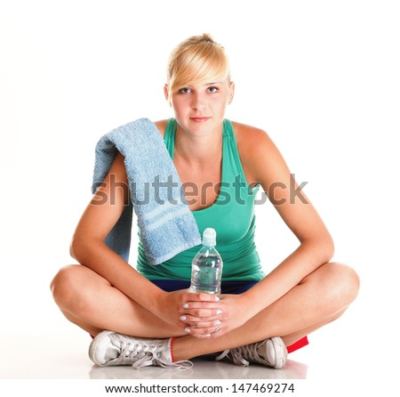 Beautiful girl drinking water from blue bottle isolated on white background - stock photo