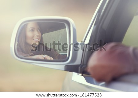 Beautiful girl driving a car