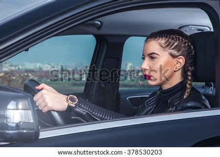 Beautiful girl driving car.