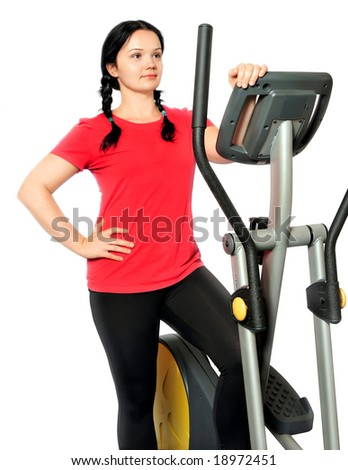 Beautiful girl during fitness time over white background - stock photo