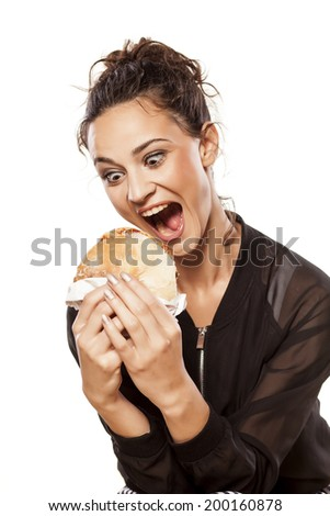 beautiful girl eagerly looking at her sandwich - stock photo