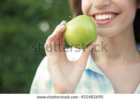 Beautiful girl eat apple, closeup - stock photo