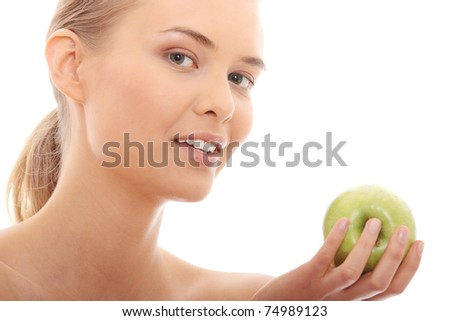 Beautiful girl eating green apple isolated on white background