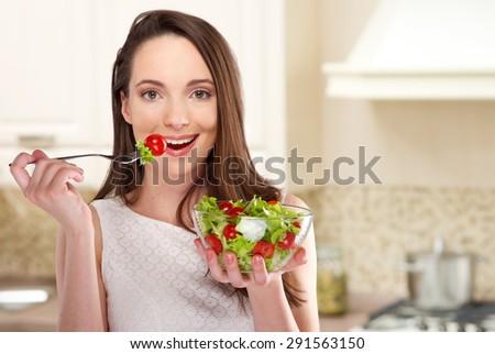 beautiful girl eating healthy food - stock photo