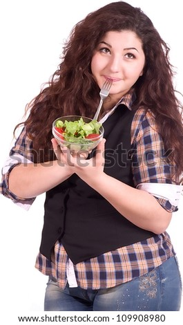 Beautiful girl eating healthy food on the white background - stock photo