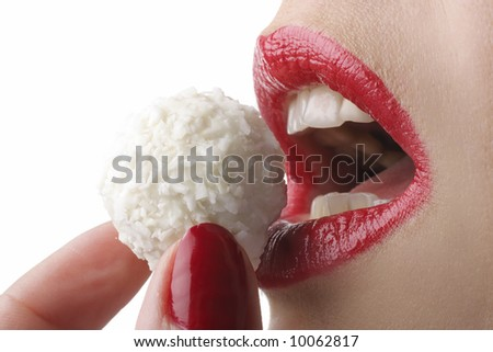 Beautiful girl eating white candy, close-up - stock photo