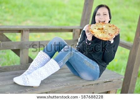 Beautiful girl eats pizza  - stock photo