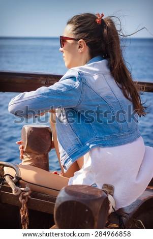 Beautiful girl enjoying on yacht - stock photo