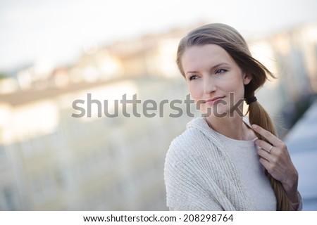 Beautiful girl enjoying the freshness on balcony - stock photo