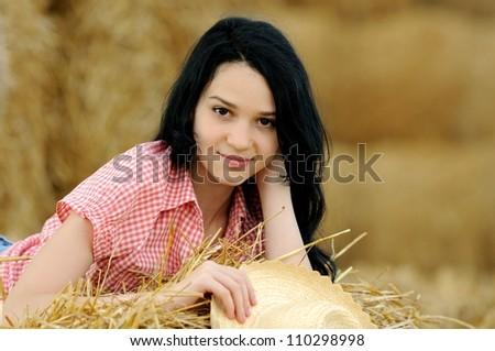 Beautiful girl enjoying the nature in the hay - stock photo