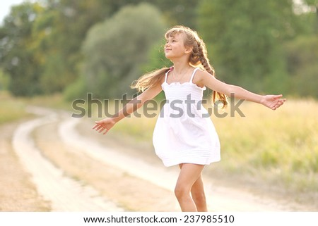 Beautiful girl enjoying the summer sun - stock photo