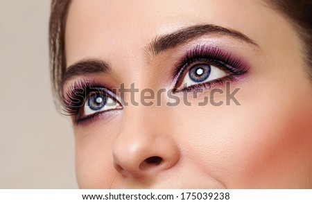 Beautiful girl eyes with perfect makeup. Closeup - stock photo