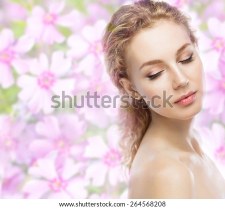 Beautiful girl face on flower  background - stock photo