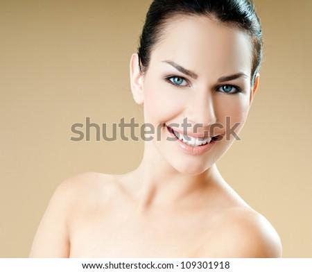 Beautiful Girl face. Perfect skin - stock photo