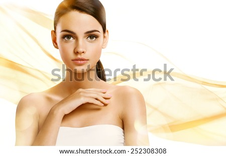 Beautiful Girl face. Perfect skin / photoset of attractive brunette girl on wavy orange background  - stock photo