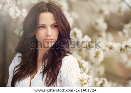 Beautiful girl face portrait close up - stock photo