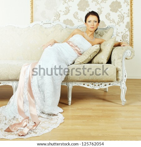Beautiful girl fashion model - evening gown, glamour interior - stock photo