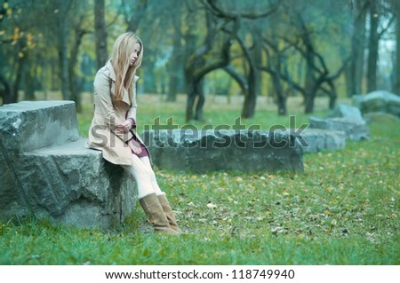 beautiful girl freezing in the park - stock photo