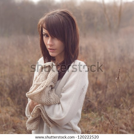 Beautiful girl freezing outdoor - stock photo