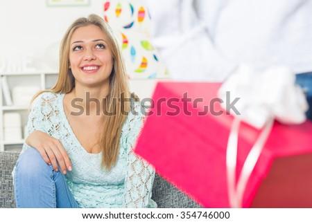Beautiful girl getting a gift form her boyfriend - stock photo