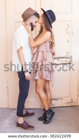 Beautiful girl giving a forehead kiss to her lover.